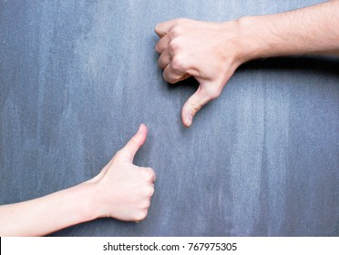 Man`s and woman`s hands showing like and dislike signs.