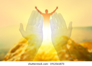 Mans worshiping hands raised up with open palms to the sky. Religion and spirituality belief concept.