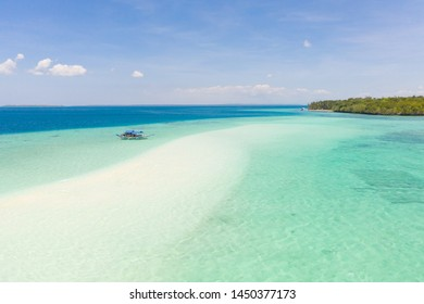 Mansalangan sandbar, Balabac, Palawan, Philippines. Tropical islands with turquoise lagoons, view from above. Boat and tourists in shallow water. - Shutterstock ID 1450377173