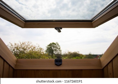 Mansard window with a view outside