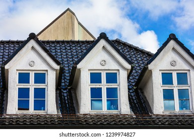 mansard windows in old style on roof in medieval house