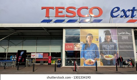 MANSFIELD, ENGLAND - FEBRUARY 1, 2019: The Exterior and sign of a modern steel and glass Tesco Extra supermarket
