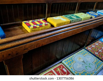 MANSFIELD, ENGLAND - JANUARY 20, 2019: Rows of pews lined with vibrany prayer cushions in St Peter's Church, Mansfield, UK