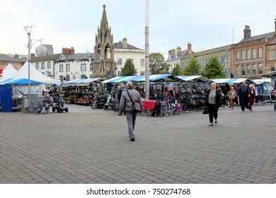 Mansfield, Nottinghamshire, UK. November 03, 2017. The memorial dominates the market stalls of the Market Square at Mansfield in Nottinghamshire, UK.