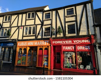 MANSFIELD, UK - DECEMBER 6, 2019:  Late C17 grade II listed house (now a Polish shop and a Fancy Dress store) with timber-framing, rendered nogging and sash windows