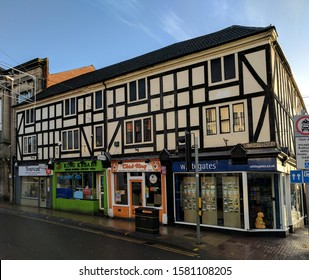 MANSFIELD, UK - DECEMBER 6, 2019:  Late C17 grade II listed house (now a shops, offices and a kebab house) with timber-framing, rendered nogging and sash windows