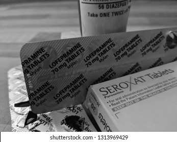 MANSFIELD, UK - FEBRUARY 14, 2019: Cocktail of prescription medication. Diazepam, Seroxat (Paroxetine) and Lofepramine in a box, foil packs and a bottle with a child proof cap