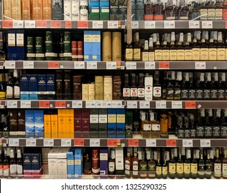 MANSFIELD, UK - FEBRUARY 27, 2019:  Supermarket shelves filled with many different types of Whiskey, Whisky and Bourbon