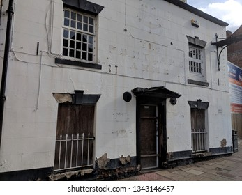 MANSFIELD, UK - MARCH 16, 2019:  Exterior of closed down, derelict pub, formerly the popular, grade II listed, 19th century stucco rendered Portland Arms pub