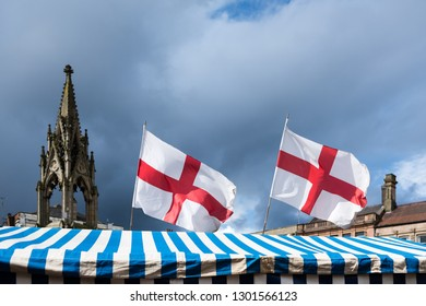 Mansfield,Nottinghamshire,UK. England's Flag of St George fly's over market stalls in the North Nottinghamshire town of Mansfield.