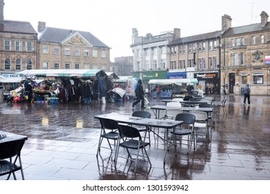 Mansfield,Nottinghamshire,UK. March 29th 2016. Mansfield historic market place on a cold Winters day. Dramatic rain clouds over surrounding retail and office buildings.