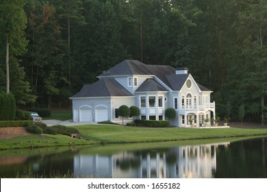 mansion by a lake, in a prestigious neighborhood