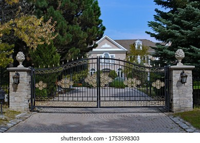 mansion with gilded gate and large garden