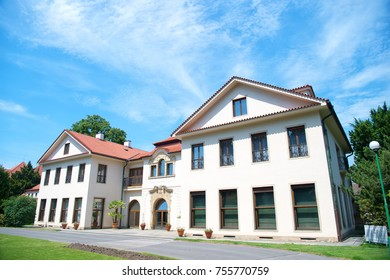 Mansion house with terracotta roof in Prague, Czech Republic, on sunny day on natural landscape. Architecture, sightseeing, travelling, wanderlust, vacation concept.