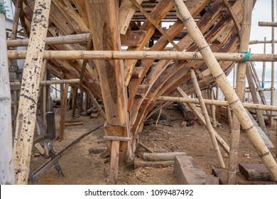 MANTA, MANABI, ECUADOR, CIRCA May 2018. Boats being built or repaired on the shore, still use wood for framing.