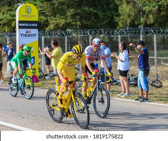 Mantes-la-Jolie, France - September 20, 2020: Tadej Pogacar in Yellow Jersey ride with Alexander Kristoff just after the start line during the last stage of Le Tour de France 2020.