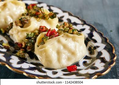 Manti, Mantu or Manty with Fried Vegetables and Spices Close Up. Vegan, Vegetarian Dumplings, Momos, Jiaozi, Dyushbara, Sikkim, Darjeeling, Ha Gao, Mandu, Manti, Pierogi, Xiao Long Bao Or Wontons