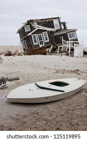 MANTOLOKING, NJ - JAN 13: A boat and home off its foundation on the beach on January 13, 2013 in Mantoloking, New Jersey. Clean up continues 75 days after Hurricane Sandy struck in October 2012.