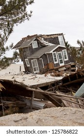 MANTOLOKING, NJ - JAN 13: A tilted house off its foundation on the beach on January 13, 2013 in Mantoloking, New Jersey. Clean up continues 75 days after Hurricane Sandy struck in October 2012.