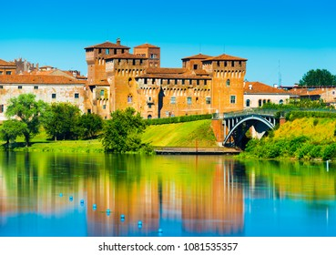 Mantova - August 2017, Italy: Castle of Saint George reflected in water. One of the main landmarks in Mantua