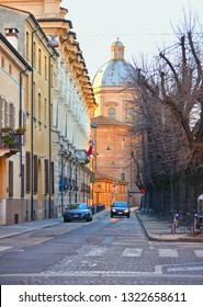 Mantova, Italy 24.02.2019. Cityscape with traffic and dome with old architecture in background in Mantua, Lombardy, Italy