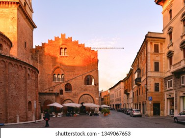 Mantova, Italy 24.02.2019. People on street, facade and old buildings and church in background in historical center of Mantua, Lombardy, Italy