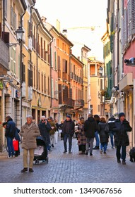 Mantova, Italy 24.02.2019. People on street, facade and old buildings in background in historical center of Mantua, Lombardy, Italy