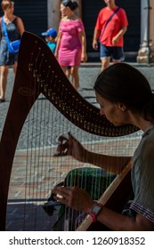 MANTOVA/ ITALY AUG 2017 - Blind Woman playing Harp in the Archway of Mantova downtown