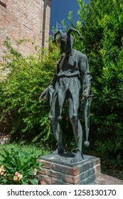 MANTOVA/ ITALY AUG 2017Rigoletto`s house with the bronze statue that can be seen in the center of the garden represents the tragic clown from the well known piece.
