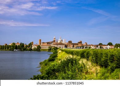Mantova, Italy. Mantua Landscapes and the historical center of the city on Background.
