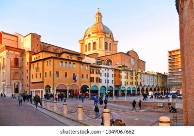 Mantova,Lombardy,Italy 24.02.2019. People on Piazza delle Erbe, one of the main squares of Mantua.Under the Colonnade there are many shops and a few bars and restaurants