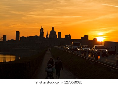 Mantova,Lombardy,Italy-2 March 2017: This is the skyline of Mantua at sunset with cars entering and leaving the city