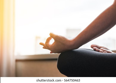 Mantra yoga meditation with woman person in lotus pose practice relaxing silently in gym class training studio or home indoor in the morning for mental health therapy and self acceptance awareness