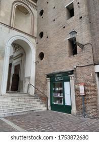 Mantua, 11 June 2020: small library at the foot of the majestic Basilica of Sant'Andrea, a distinguished work of the Renaissance architect Leon Battista Alberti.