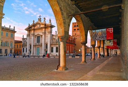 Mantua, Italy 24.02.2019. The famous Renaissance square Piazza Sordello in Mantua seen under arches of Palazzo Ducale , Lombardy, , cathedral San Pietro and Palazzo Ducale.