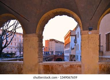 MANTUA - ITALY 29.02.2019. panorama of water canal from The Pescherie di Giulio Romano (or Loggia di Giulio Romano), a historical old fishmarket building in center of Mantua (Mantova)