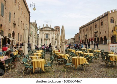 Mantua, Italy - April 10, 2018: The famous Renaissance square Piazza Sordello in Mantua, Lombardy, Northern Italy. Cafe terrace, cathedral San Pietro and Palazzo Ducale. South Europe.