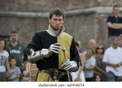 Mantua, Italy - August 26, 2012. Reenactor taking part to a medieval event which celebrates a battle occurred in XIV Century. Medieval warrior/soldier on the battlefield