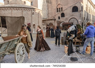 MANTUA, ITALY - OCTOBER 1: extras dressed as Renaissance courtiers and tramps  near san Francesco church during the shooting of a costume drama; shot on oct 1 2017 in Mantua, Italy