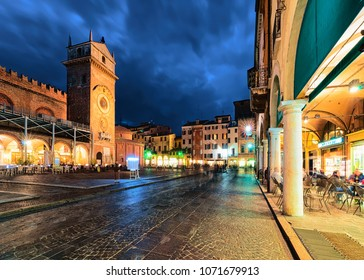 Mantua, Italy - October 22, 2016: Via Broletto Street and Piazza delle Erbe Square in Mantua, Lombardy, Italy. Late in the evening