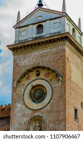 MANTUA, LOMBARDY, ITALY - May 23, 2018: View of the Torre dell'Orologio built in 1473 by Luca Fancelli in Piazza delle Erbe. The astronomical clock is an invention by Bartolomeo Manfredi.
