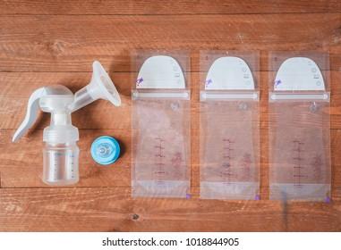 manual breast pump and milk bags. Copy space. Flatlay.