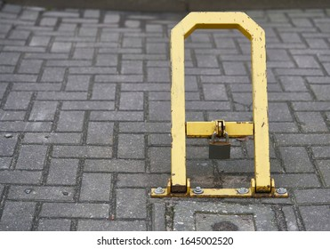 Manual car parking barrier with lock and stop sign. Car parking lock device. Dedicated parking for guests. Traffic rules, prohibitory signs - Shutterstock ID 1645002520