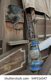 Manual coffee grinder and blue lamp on the outside of a wild west chuck wagon
