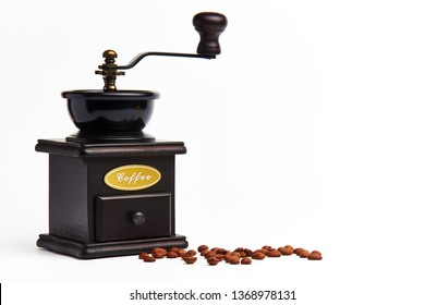Manual coffee grinder for grinding coffee beans. White background.