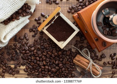 Manual coffee grinder on wooden table table top view
