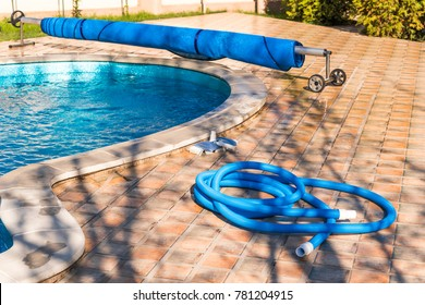 Manual equipment for cleaning pool, brush, hose, swimming pool cover,  Copy space for text