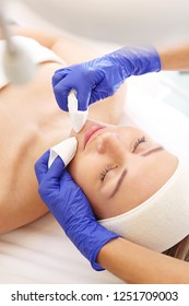 Manual facial cleansing. Cleansing facial skin, beautician squeezed blackheads.