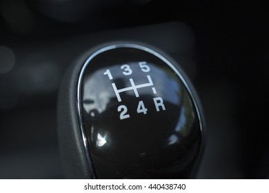 Manual gear stick of a new and modern car.