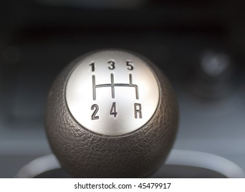 Manual gearbox seen from upwards, metal and black plastic
